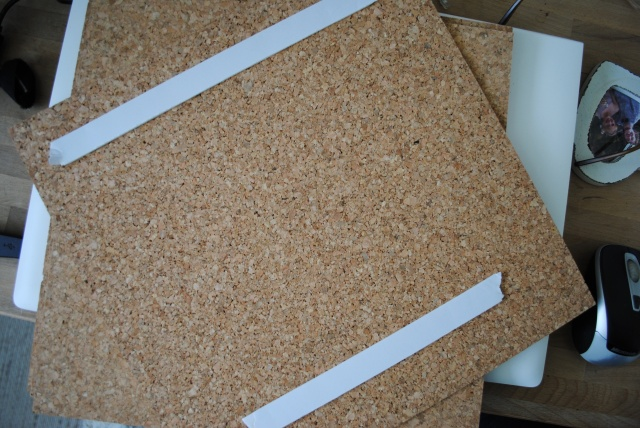 Applying tape to cork floor tiles